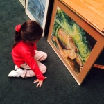 kid looking at adam painting